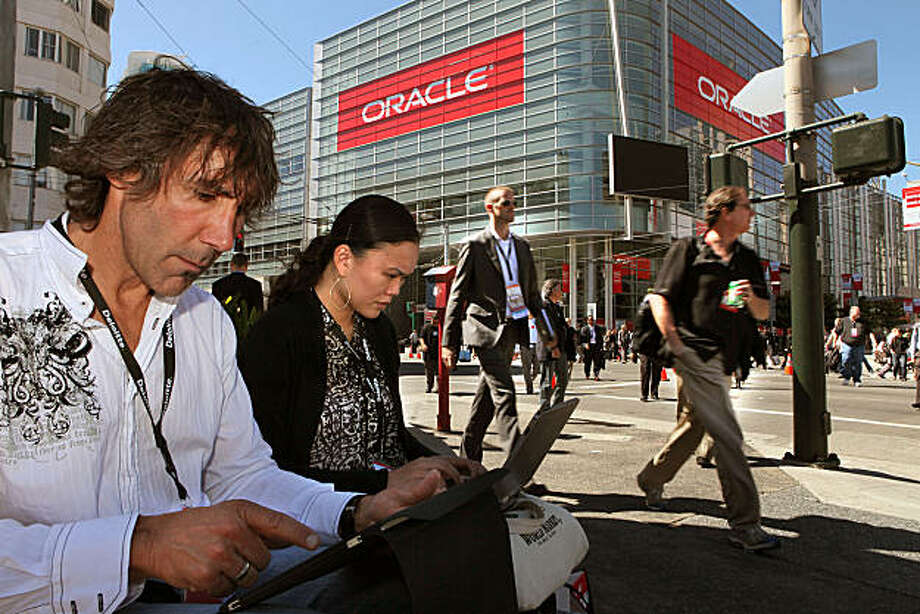 Manager John Tobin (left) and Kim Nguyen (middle) from Sharp healthcare in San Diego, take a lunch break during Oracle World at Moscone Convention center in San Francisco, Calif., on Monday, September 20, 2010. Photo: Liz Hafalia, The Chronicle