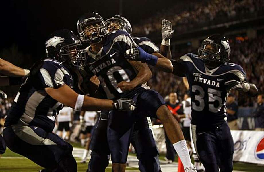 Nevada's Colin Kaepernick celebrates one his second touchdown in the first half of an NCAA college football game Friday, Sept. 17, 2010,against California in Reno, Nevada. Photo: Lance Iversen, The Chronicle