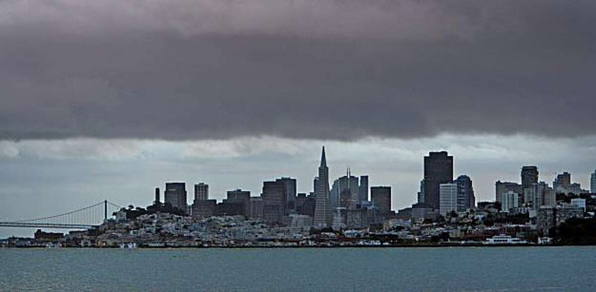 Heavy rain clouds loom over the skyline of San Francisco as seen from Sausalito, Calif., on December 15, 2008.
