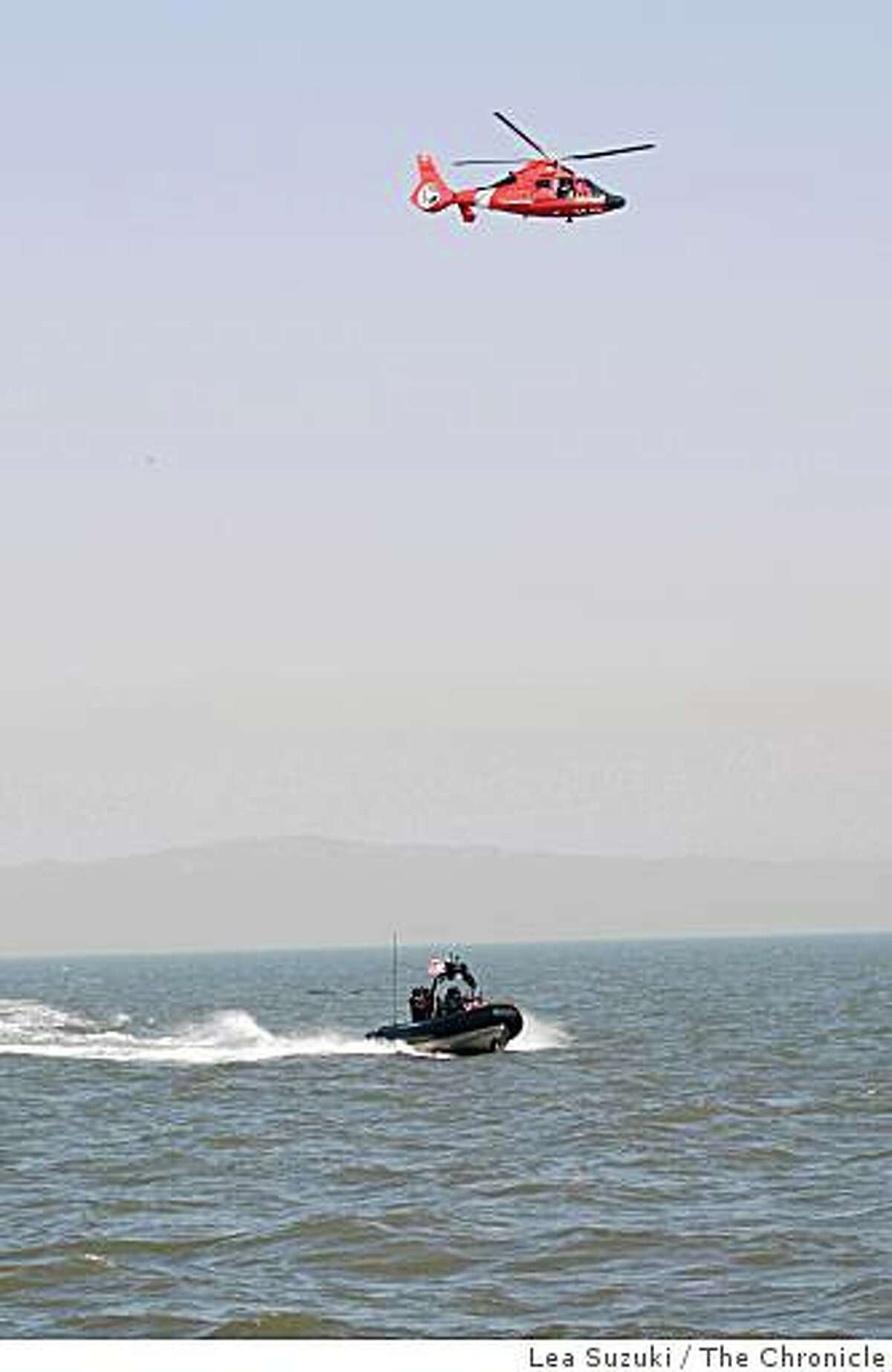 A U.S. Coast Guard armed helicopter and a U.S. Coast Guard boat with members of the Maritime Safety and Security Team conduct a training exercise in the San Pablo Bay on Monday, February 2, 2009.