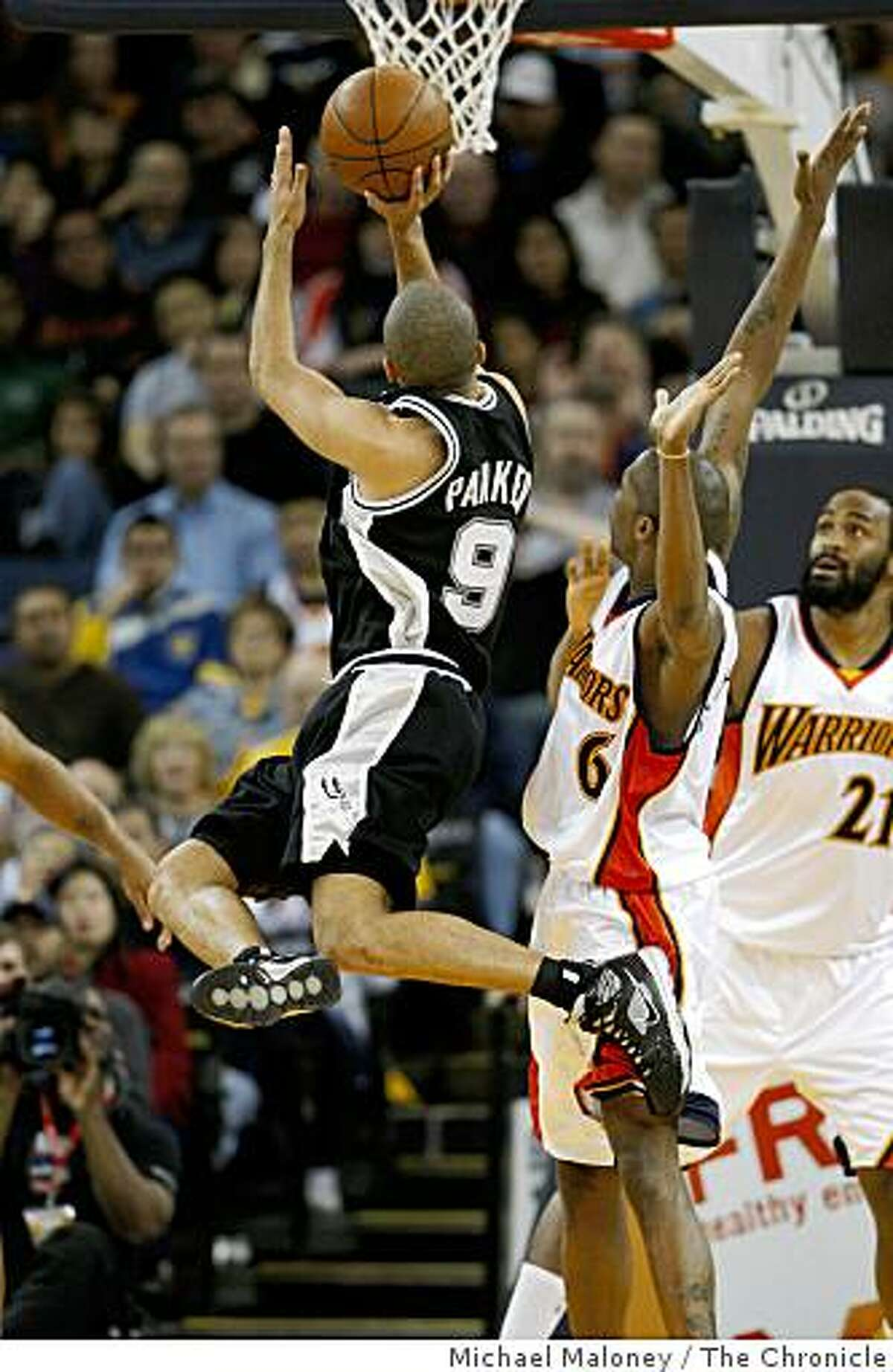 San Antonio Spurs Tony Parker (9) goes up for a shot against Golden State Warriors Jamal Crawford (6) and Ronny Turiaf (21) during a NBA game at Oracle Arena in Oakland, Calif., on Monday, February 2, 2009.