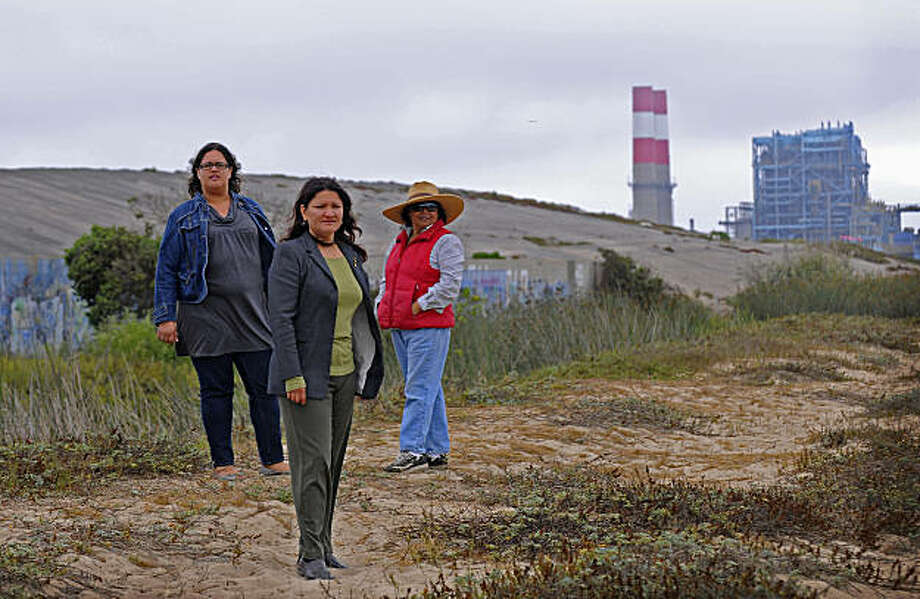 Beatriz Garcia, (L-R) Lead Organizer of Central Coast Alliance United for a Sustainable Economy, (CAUSE), Maricela Morales, Associate Executive Director of CAUSE, and Gloria Roman, Vice President of CAUSE, stand in front of Halaco, a Superfund site designated as highly toxic by the EPA. The mound behind them on the left is a slag pile that is seeping toxic materials into the ground water and is immediately adjacent to coastal wetlands. The land is next to the Power Plant on the right, but not connected.  However CAUSE and other organizations want to restore the natural wetlands and remove as much of the industry from this coastal area as possible.  Photo was taken September 3, 2010. Photo: Jamie Rector, Special To The Chronicle