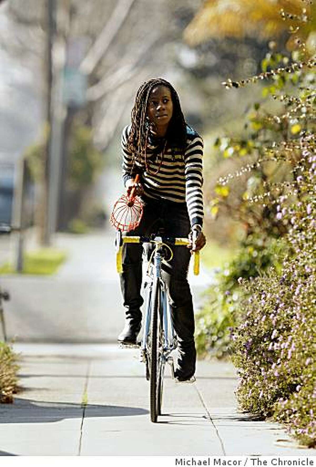 Asiya Wadud, searches the streets for fruit trees in the Rockridge area of Berkeley, Calif., on Friday Jan. 30, 2008. Wadud has an obsession with saving city-grown fruit from being wasted.