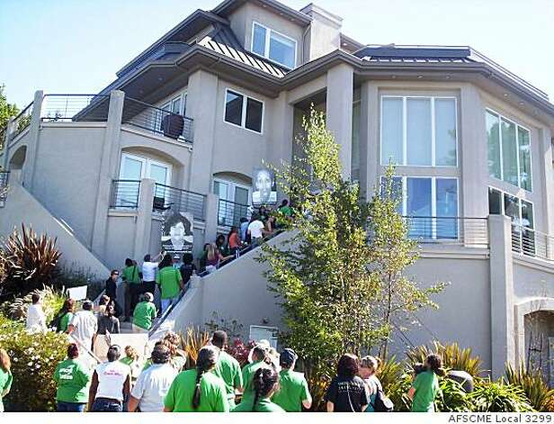 University of California workers protest salaries at the Oakland Hills home of UC President Mark Yudof in Oakland, Calif. Photo: AFSCME Local 3299