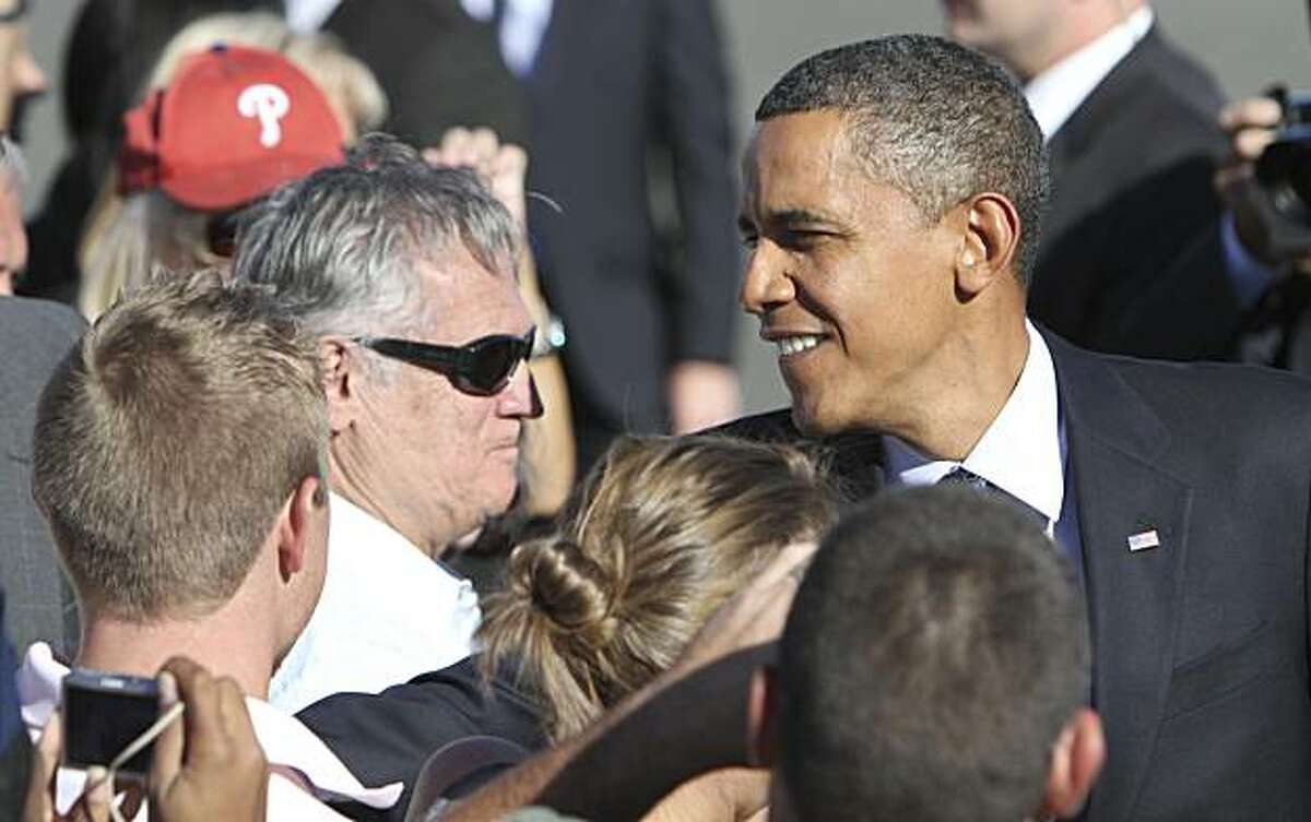 President Barack Obama shakes hands with supporters upon his arrival at Philadelphia International Airport in Philadelphia, Monday Sept. 20, 2010.