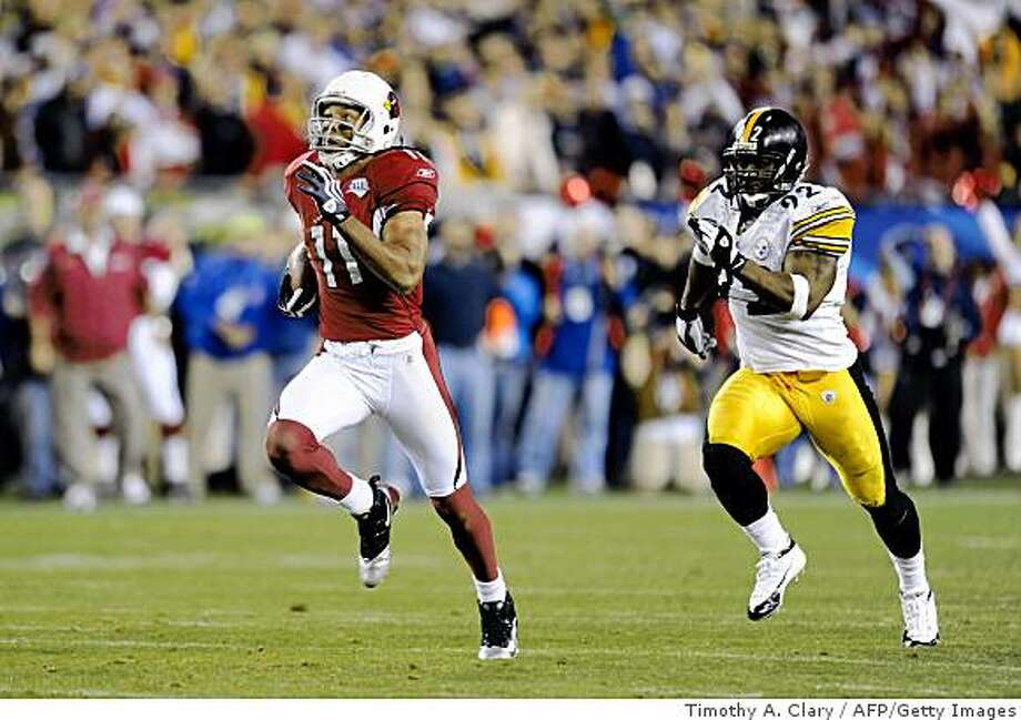 Larry Fitzgerald (#11) of the Arizona Cardinals breaks away from James Harrison (#92) of the Pittsburgh Steelers for a touchdown during Super Bowl XLIII on February 1, 2009 at Raymond James Stadium in Tampa, Florida.  The Steelers edged Arizona 27-23 for their sixth Super Bowl title.    AFP PHOTO / TIMOTHY A. CLARY (Photo credit should read TIMOTHY A. CLARY/AFP/Getty Images) Photo: Timothy A. Clary, AFP/Getty Images