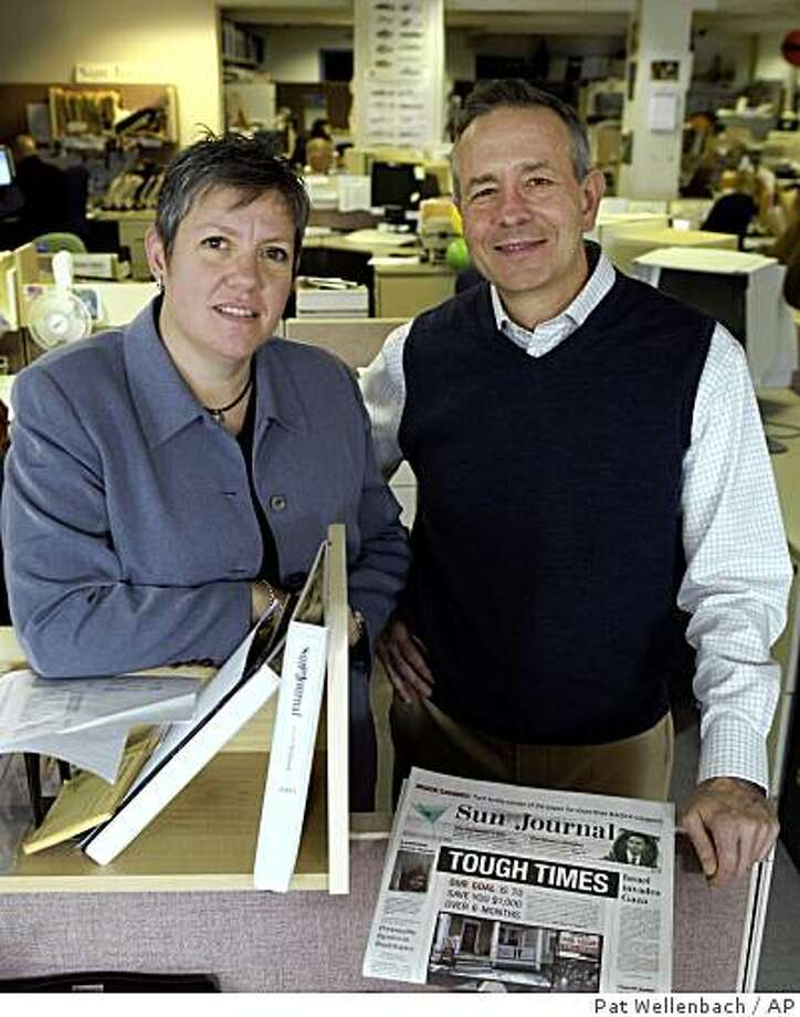 **APN ADVANCE FOR SUNDAY FEB.1**  Executive Editor Rex Rhoades,right, and Managing Editor Judy Meyer stand in the news room at the Lewiston Journal newspaper in Lewiston, Maine, on Wednesday, Jan. 14, 2009. Every day for six months, the Sun Journal is featuring a front-page box containing a penny-pinching tip that editors hope will add up to $1,000 or more in savings for each reader by the time the series concludes.(AP Photo/Pat Wellenbach) Photo: Pat Wellenbach, AP