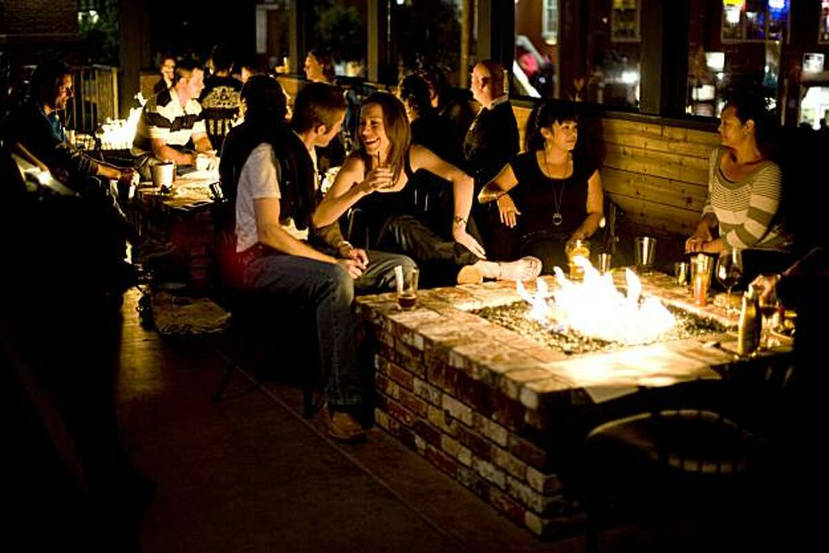 The restaurant Cannery Row Brewing Company in Monterey, Calif., features 3 fire pits on the back patio which are regularly packed with people and is seen on Sunday, September 5, 2010.
