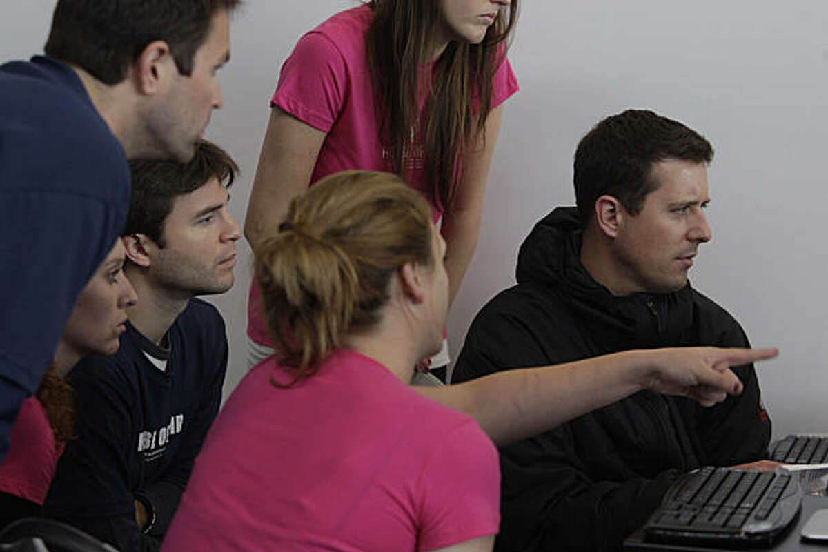 Paul McGeehan (right) goes over workflow with House of Air flight crew staff at House of Air in San Francisco, Calif. on Wednesday September 15, 2010.