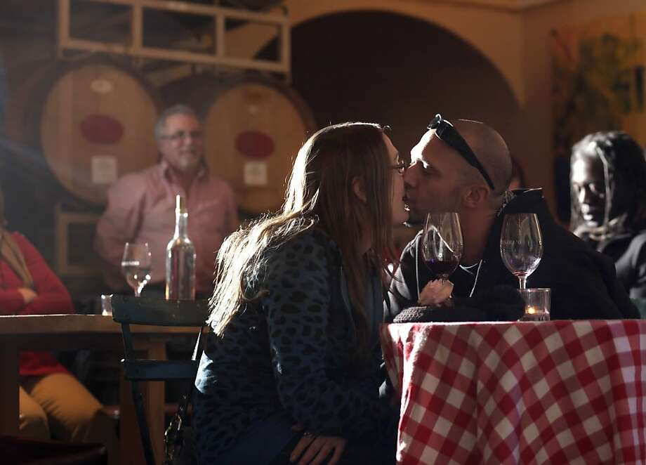 Amber Richards and Michael Whitt kiss as they listen to music and enjoy a little wine  at the D'Argenzio Winery, Thursday January 5, 2012,  in  Santa Rosa Calif. Photo: Lacy Atkins, The Chronicle