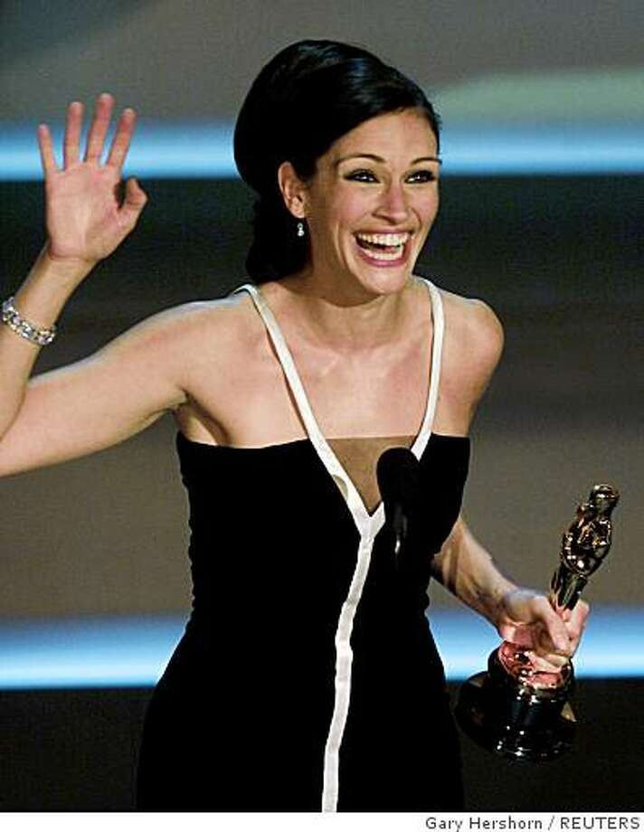 """Julia Roberts accepts her Oscar for Best Actress at the 73rd annual Academy Awards in Los Angeles March 25, 2001. Roberts won for her role in """"Erin Brockovich."""" Photo: Gary Hershorn, REUTERS"""