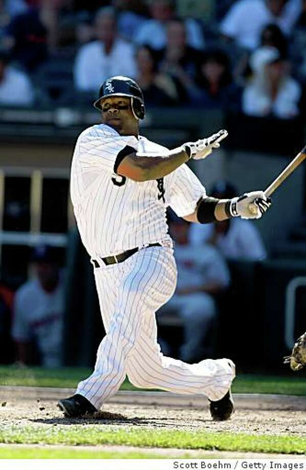 Third baseman Juan Uribe (5) of the Chicago White Sox follows through on his swing after hitting the baseball against the Boston Red Sox at US Cellular Field on August 10, 2008 in Chicago, Illinois. Photo: Scott Boehm, Getty Images