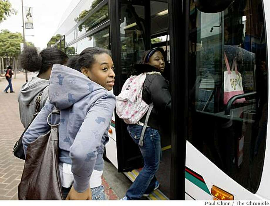 Imani Polar, left, and Sharhonda Harris, right, board an AC Transit bus on Shattuck Avenue in Berkeley, Calif., on Tuesday, April 22, 2008. Transit district officials are considering several proposals to raise fares.Photo by Paul Chinn / San Francisco Chronicle Photo: Paul Chinn, The Chronicle