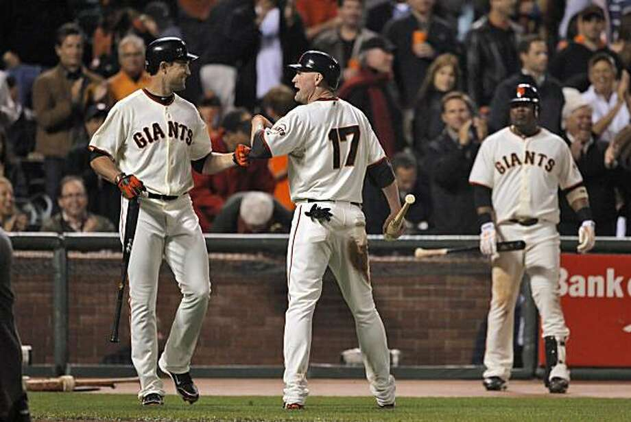 Pat Burrell congratulates Aubrey Huff after Huff scored in the bottom of the first inning to tie the game. The San Francisco Giants played the Los Angeles Dodgers at AT&T Park in San Francisco, Calif., on Thursday, September 16, 2010, defeating the Dodgers 10-2. Photo: Carlos Avila Gonzalez, The Chronicle