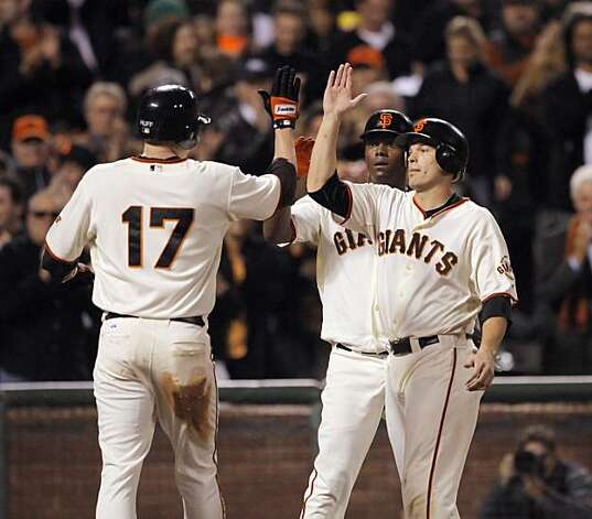 Aubrey Huff, left, high fives Edgar Renteria, center, and Freddy Sanchez, right after hitting a three-run homerun that scored Renteria and Sanchez. The San Francisco Giants played the Los Angeles Dodgers at AT&T Park in San Francisco, Calif., on Thursday, September 16, 2010, defeating the Dodgers 10-2. Photo: Carlos Avila Gonzalez, The Chronicle