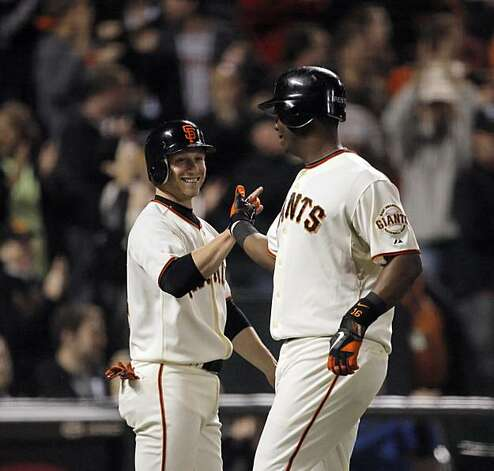Mike Fontenot high fives Edgar Renteria after they scored on Freddy Sanchez double in the eighth. The San Francisco Giants played the Los Angeles Dodgers at AT&T Park in San Francisco, Calif., on Thursday, September 16, 2010, defeating the Dodgers 10-2. Photo: Carlos Avila Gonzalez, The Chronicle
