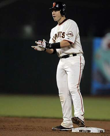 Buster Posey claps after hitting an rbi double that scored Aubrey Huff to tie the game in the first inning. The San Francisco Giants played the Los Angeles Dodgers at AT&T Park in San Francisco, Calif., on Thursday, September 16, 2010, defeating the Dodgers 10-2. Photo: Carlos Avila Gonzalez, The Chronicle