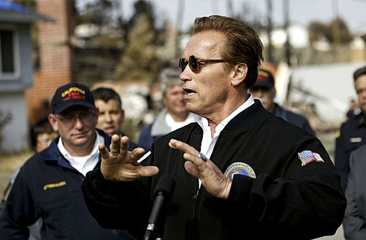 Governor Arnold Schwarzenegger speaks to the media, promising to get to the bottom of the cause of last weeks natural gas explosion as he visited the site on Wednesday Sept. 15, 2010, San Bruno, Calif.