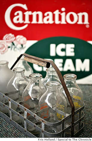 Vintage milk bottles and an advertisment for Carnation Ice Cream sit in the lobby of the Sunnyside Cream Winery in Sunnyside, WA Saturday, January 24, 2009. The former Carnation milk processing plant is in the process of being converted into a fully operational winery. Photo: Kris Holland, Special To The Chronicle
