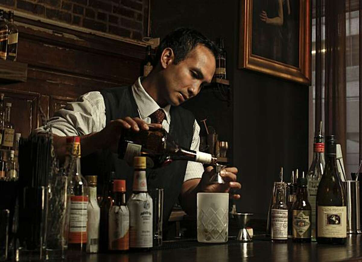 Kevin Diedrich on Tuesday Sept. 14, 2010, in San Francisco, Calif., a bartender at the Burritt Room inside the Crescent Hotel, just off union Square, creates the Flying Horseman cocktail, a low-alcohol drink.