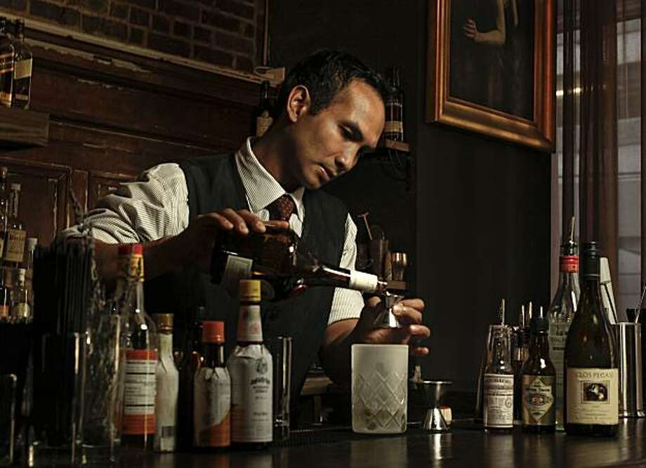 Kevin Diedrich on Tuesday Sept. 14, 2010,  in San Francisco, Calif., a bartender at the Burritt Room inside the Crescent Hotel, just off union Square,  creates  the Flying Horseman cocktail, a low-alcohol drink. Photo: Michael Macor, The Chronicle
