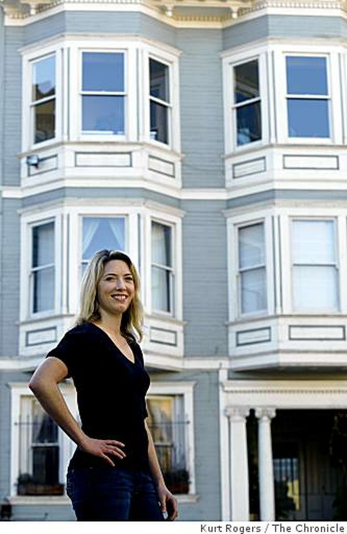 Elizabeth Johnson poses front of her condo building on Friday Jan. 30, 2009 in San Francisco, Calif. She and her two coowners are entering the condo lottery for the fifth time next week.