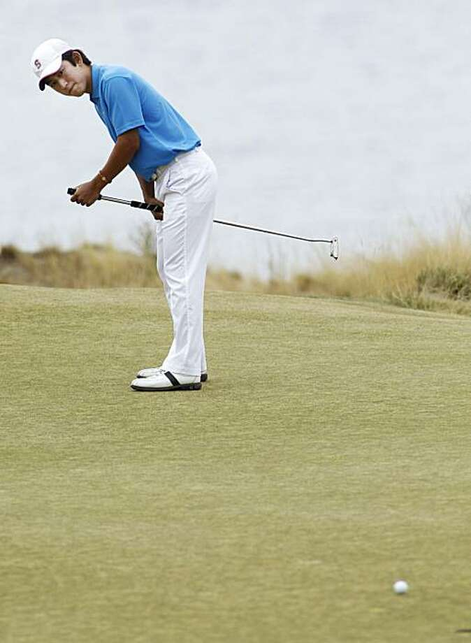 David Chung reacts to a putt on the 33rd hole in the final round of the U.S. Amateur golf tournament, Sunday, Aug. 29, 2010, at Chambers Bay in University Place, Wash. Peter Uihlein beat Chung to win the championship. Photo: Ted S. Warren, AP