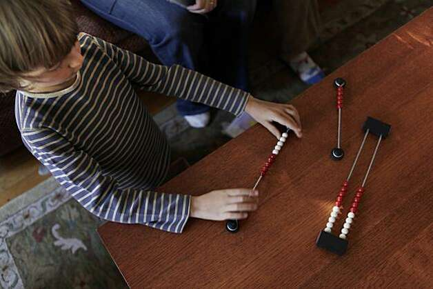 Cameron Edwards, 5, plays with math sticks on Monday, September 13, 2010. The sticks were math lesson aides before his mom had him start using dreambox. Elisa Edwards, a Berkeley mom of three and a math teacher at Berkeley's Berkwood Hedge independent elementary school, uses DreamBox at home and also recommends it to her students at school. Photo: Carlos Avila Gonzalez, The Chronicle