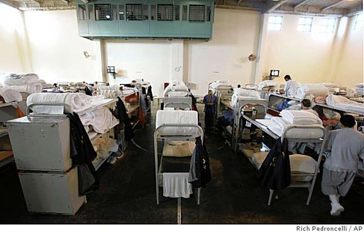 Triiple tier bunks are seen in a gymnasium converted to house prisoners at the California Substance Abuse Treatment Facility and State Prison in Corcoran, Calif., Wednesday, Jan. 14, 2009. Clark Kelso, the federal receiver appointed to oversee the medical care in California prisons, filed a report in federal court, Tuesday, saying that physically and mentally ill inmates can't get proper care at four isolated prisons in the Central Valley, including those located in Corcoran. (AP Photo/Rich Pedroncelli)
