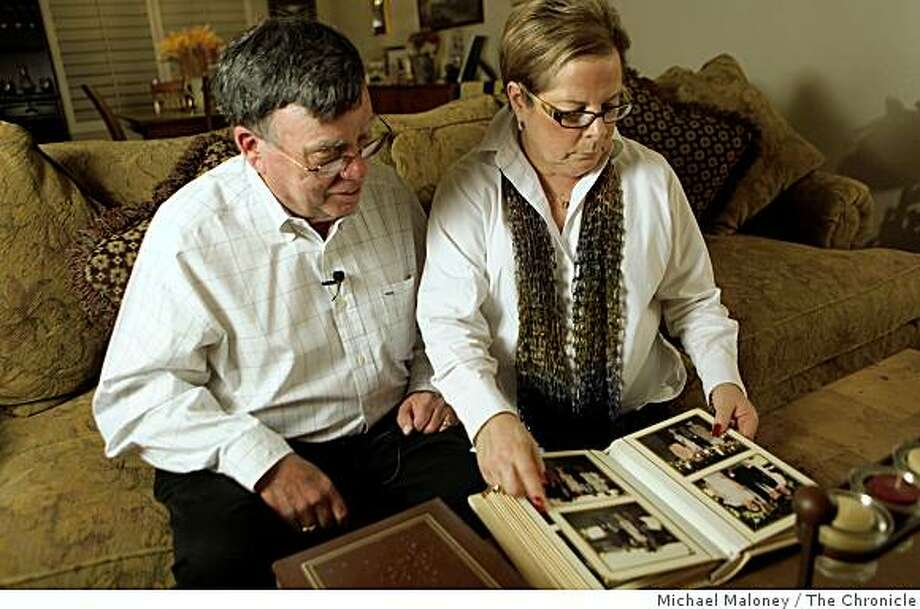 Mike and Maddi Misheloff look at a family album as they talk about the 20 year anniversary of their missing daughter Ilene Misheloff in the living room of their Dublin, Calif. home on January 28, 2009.Twenty years ago this Friday, their daughter 13-year-old Ilene Misheloff disappeared in the placid town of Dublin while walking home from school -- and she has never been seen since. Photo: Michael Maloney, The Chronicle