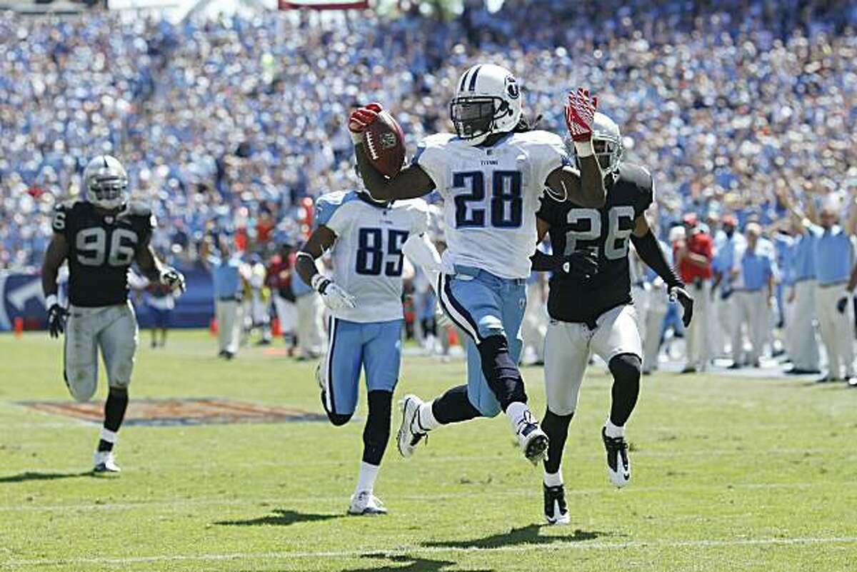 NASHVILLE - SEPTEMBER 12: Chris Johnson #28 of the Tennessee Titans runs into the end zone for a 76-yard touchdown in the first half of the NFL season opener against the Oakland Raiders at LP Field on September 12, 2010 in Nashville, Tennessee.