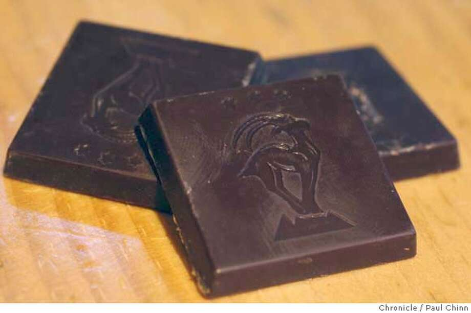 Five gram squares of dark chocolate at the Scharffen Berger chocolate factory in Berkeley, Calif. on Tuesday, July 3, 2007. A study by German researchers claims that a daily dose of dark chocolate helps lower blood pressure.  PAUL CHINN/The Chronicle Photo: PAUL CHINN