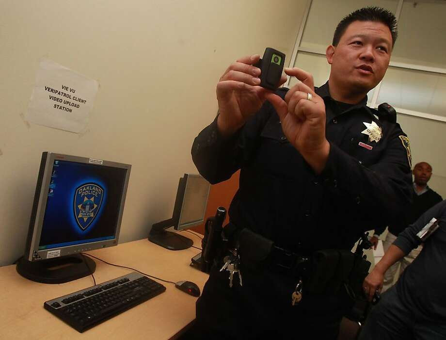 Oakland officer Lawrence Low shows his camera after downloading his video showing the issuing of the ticket back at Eastmont station in Oakland, Calif., on Wednesday, September 15, 2010. Photo: Liz Hafalia, The Chronicle