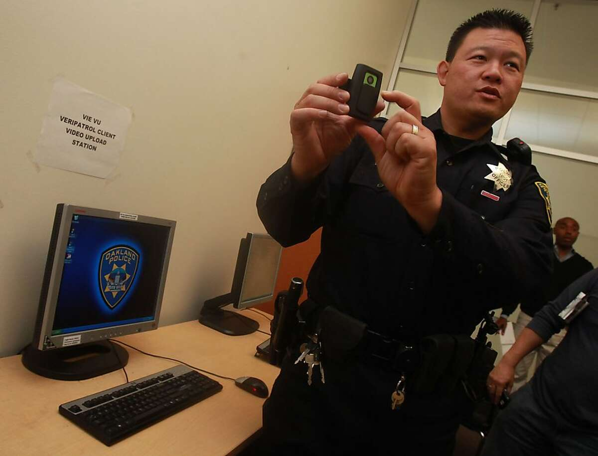 Oakland officer Lawrence Low shows his camera after downloading his video showing the issuing of the ticket back at Eastmont station in Oakland, Calif., on Wednesday, September 15, 2010.