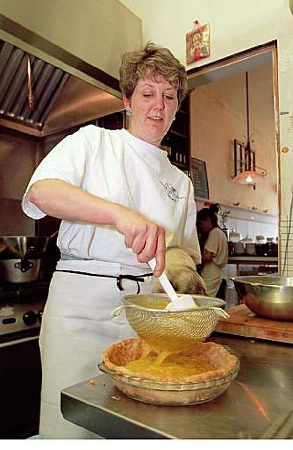 "DINING 09 b /28MAR95/DD/MACOR ""CAFE LIBERTY"" in SF. Owner and chef Cathie Guntli make a lemon meringue pie. Chronicle Photo: Michael Macor Photo: Michael Macor, SFC"