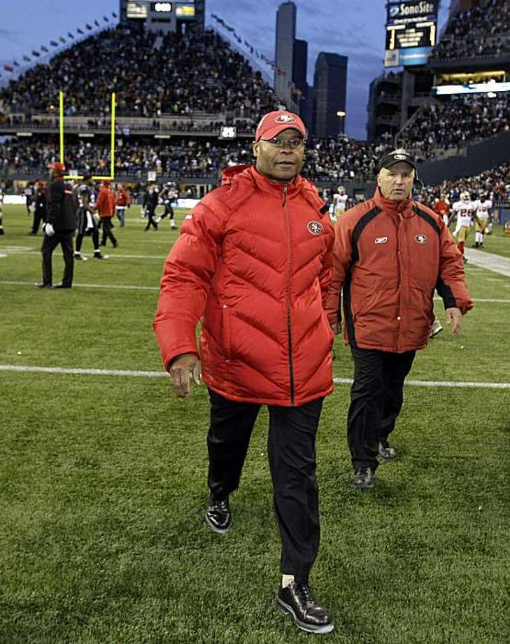 San Francisco 49ers head coach Mike Singletary walks off the field after the Seattle Seahawks beat the 49ers 20-17 in an NFL football game, Sunday, Dec. 6, 2009, in Seattle. (AP Photo/Ted S. Warren) Photo: Ted S. Warren, AP