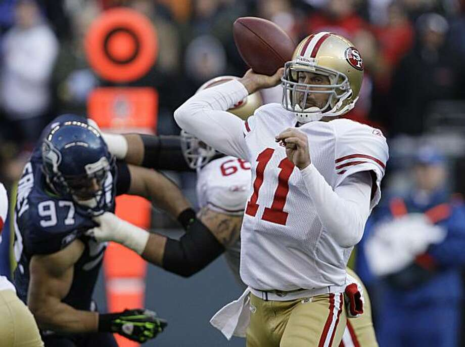 San Francisco 49ers quarterback Alex Smith throws against the Seattle Seahawks in the first quarter during an NFL football game, Sunday, Dec. 6, 2009, in Seattle. The Seahawks won 20-17. Smith, who didn't have a 300-yard passing day in his first 38 NFL games, threw for 310 in the 49ers' new pass-happy offense. (AP Photo/Elaine Thompson) Photo: Elaine Thompson, AP