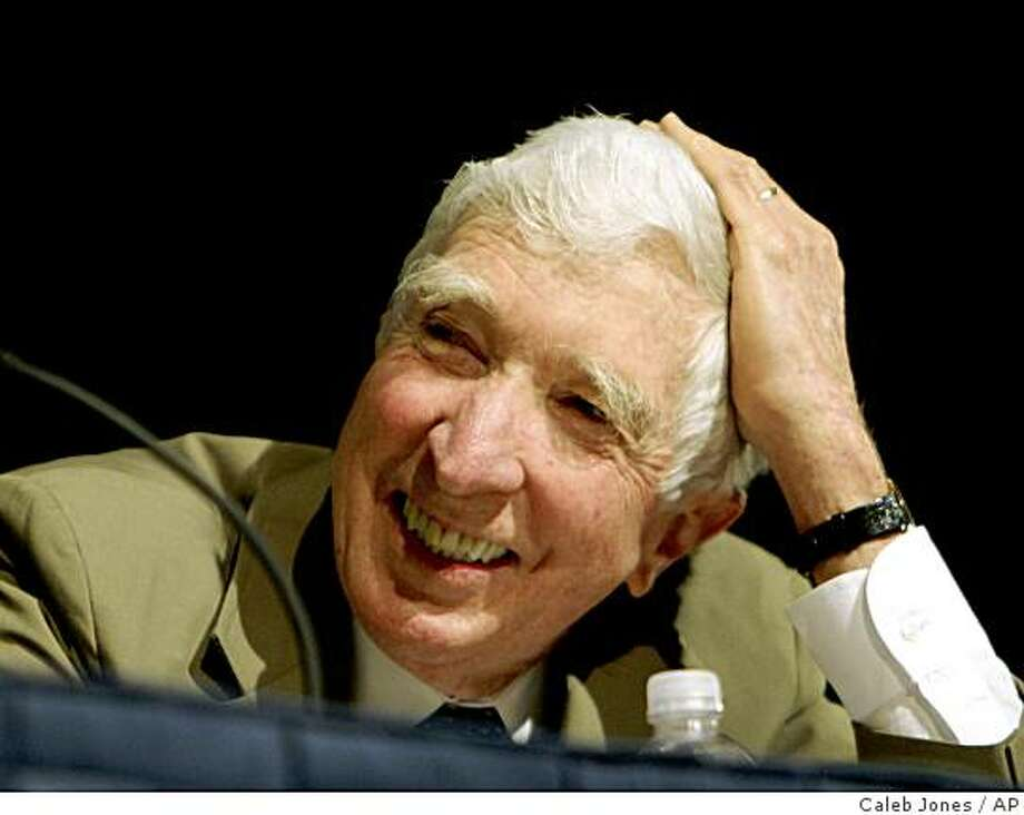 ** FILE  ** In this May 20, 2006 file photo, author John Updike takes part in a panel discussion at BookExpo America 2006 in Washington. Updike, the Pulitzer Prize-winning novelist, prolific man of letters and erudite chronicler of sex, divorce and other adventures in the postwar prime of the American empire, died Tuesday, Jan. 27, 2009, of lung cancer, according to a statement from his publisher, Alfred A. Knopf. He was 76. (AP Photo/Caleb Jones,File) Photo: Caleb Jones, AP