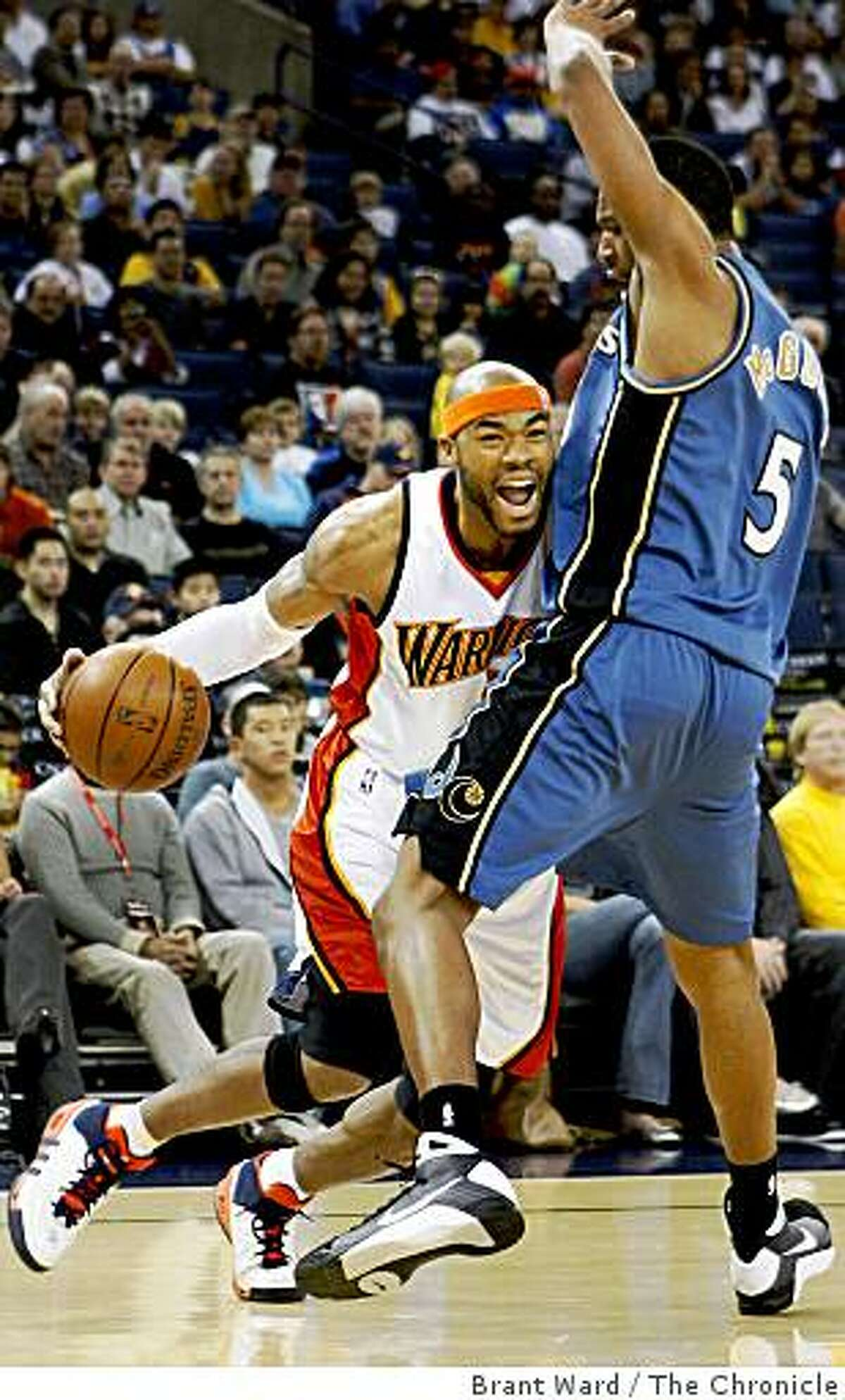 Warriors Corey Maggette makes a move against the Wizards Dominic McGuire in the first half a game vs. the Wizards Monday January 19, 2009.