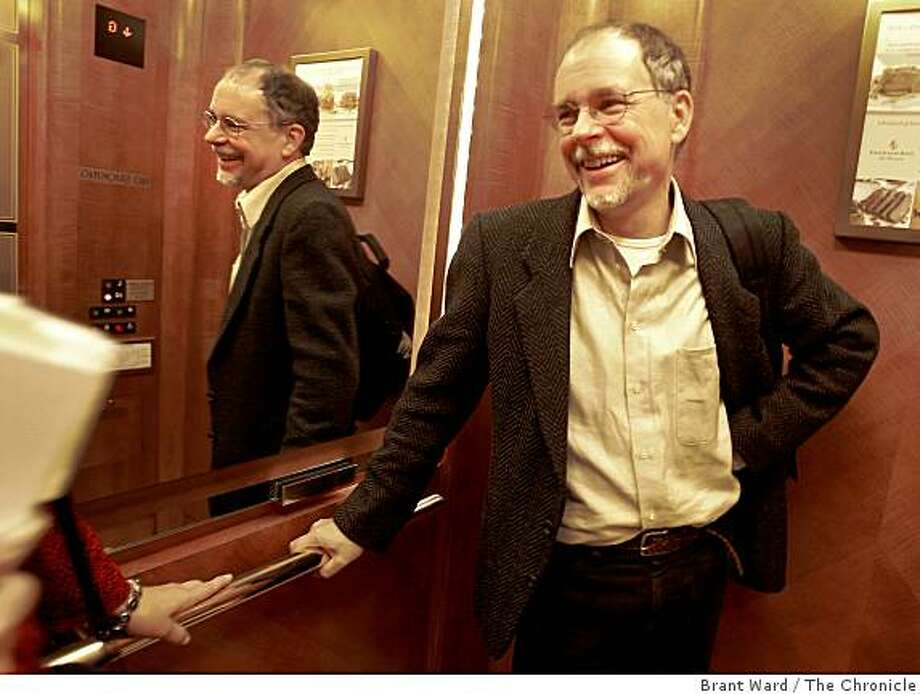 "Author Maguire talks with an associate on his way to another interview. Gregory Maguire, author of ""Wicked"" has written a third novel based on the Wizard of Oz story about the cowardly lion. He is photographed at the Four Seasons Hotel in San Francisco Tuesday October 14, 2008. Photo: Brant Ward, The Chronicle"