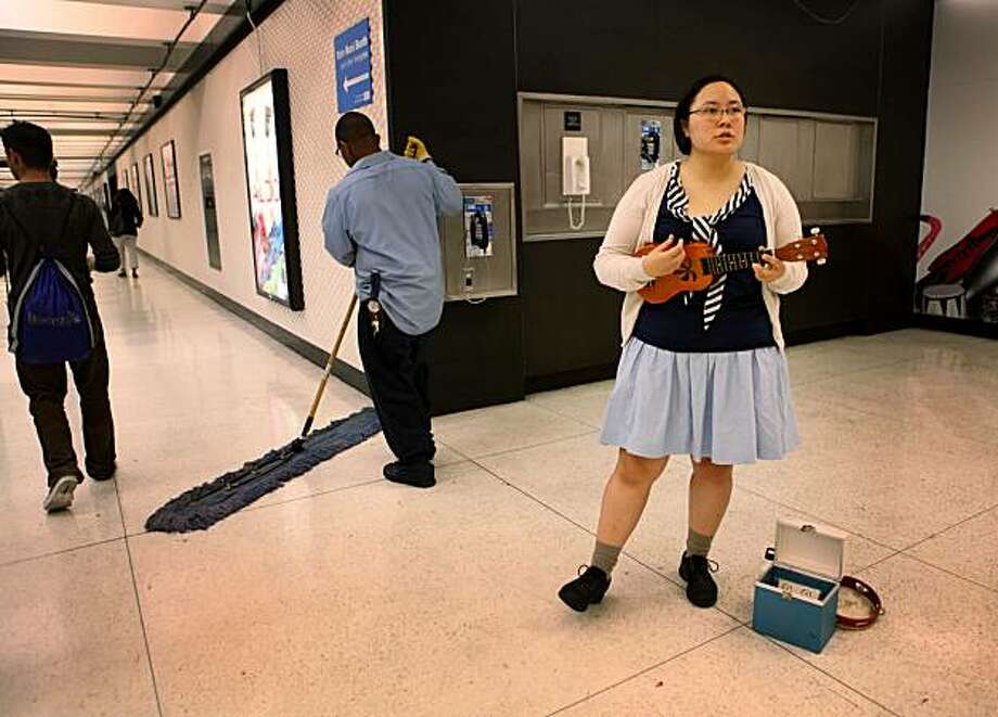 Ester Kang a.k.a. Banty Hen performs with her ukulele inside the Powell Street BART station on Friday Sept. 10, 2010 in San Francisco, Calif. Photo: Mike Kepka, The Chronicle
