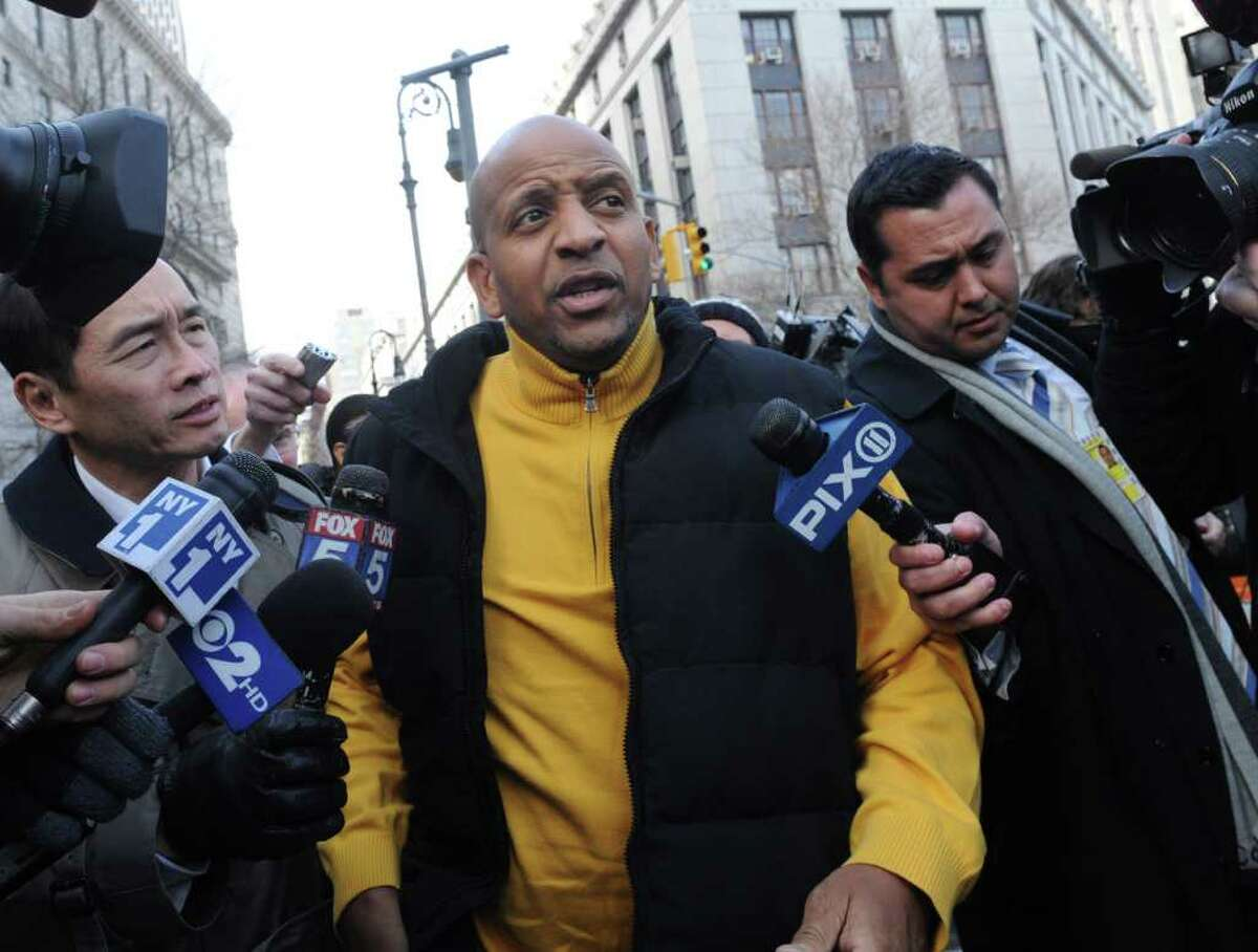 Carl Tyson, center, whose daughter Carlina White was kidnapped as a newborn from Harlem Hospital in August 1987, exits Manhattan Federal court, Friday, Feb. 10, 2012, in New York. A prosecutor in a case against Raleigh, North Carolina, resident Ann Pettway, the woman accused of snatching the newborn, says she will plead guilty Friday to criminal charges. (AP Photo/ Louis Lanzano)