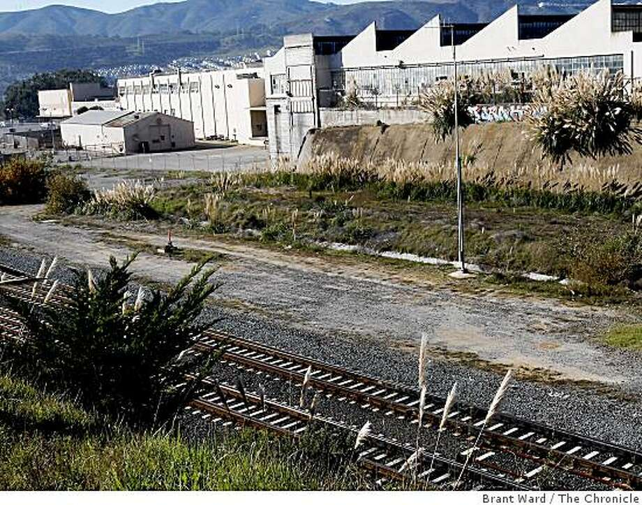 The former Schlage lock factory in background with the tracks of CalTrain in foreground. The new redevelopment project would take advantage of both Muni and CalTrain transportation hubs nearby. The site of the former Schlage lock company and points south in San Francisco's Visitacion Valley are scheduled for an ambitious redevelopment plan. Photo: Brant Ward, The Chronicle