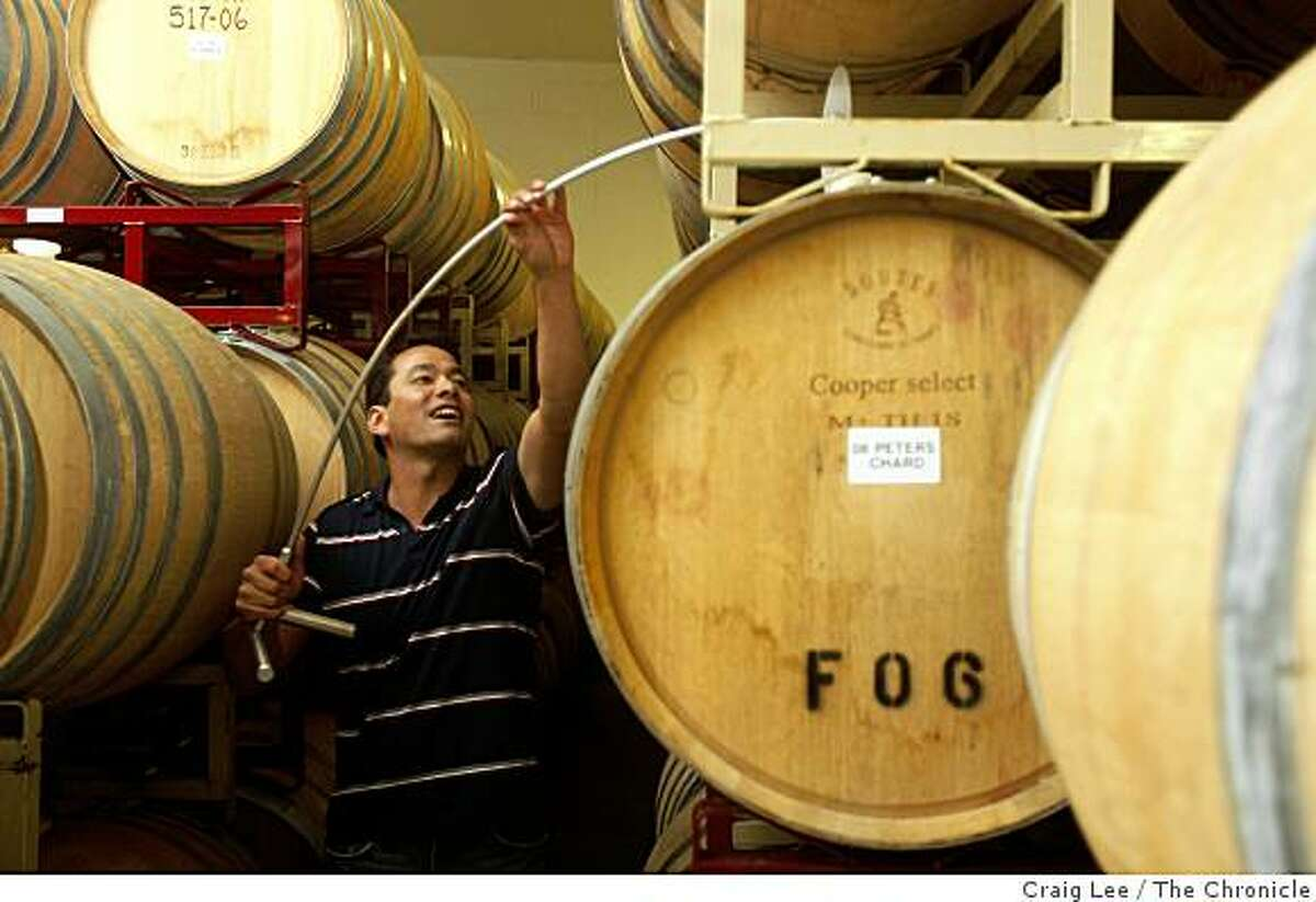 David Low of Anthill Farms WInery, stirring the lees of the wines in the barrels in Healdsburg, Calif., on January 16, 2009.