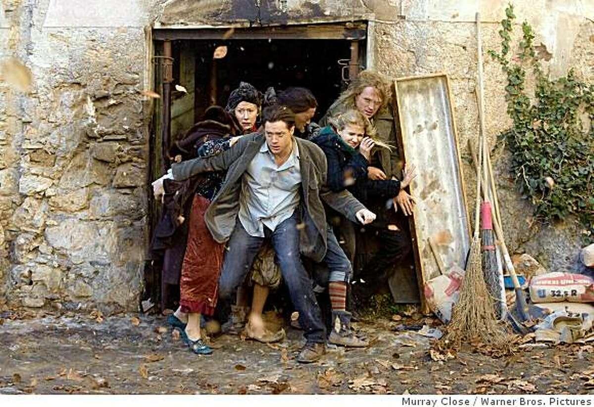 HELEN MIRREN as Elinor, BRENDAN FRASER as Mo, RAFI GAVRON as Farid, ELIZA HOPE BENNETT as Meggie and PAUL BETTANY as Dustfinger in New Line Cinema's fantasy adventure