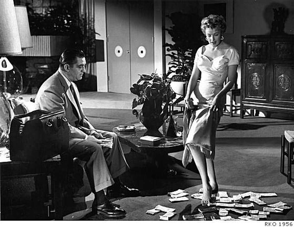 """Ted de Corsia and Arlene Dahl in """"Slightly Scarlet,"""" part of the 2009 Noir City Festival.Actress Arlene Dahl, shown here with Ted deCorsia in the 1956 film Slightly Scarlet, will be the Guest of Honor at Noir City 7 on Saturday night, Janaury 24 at the Castro Theatre. The bill will feature this rare color noir, as well as Wicked as They Come, in which Ms. Dahl plays a conniving femme fatale. She will be interviewed onstage between films by festival producer and host Eddie Muller."""