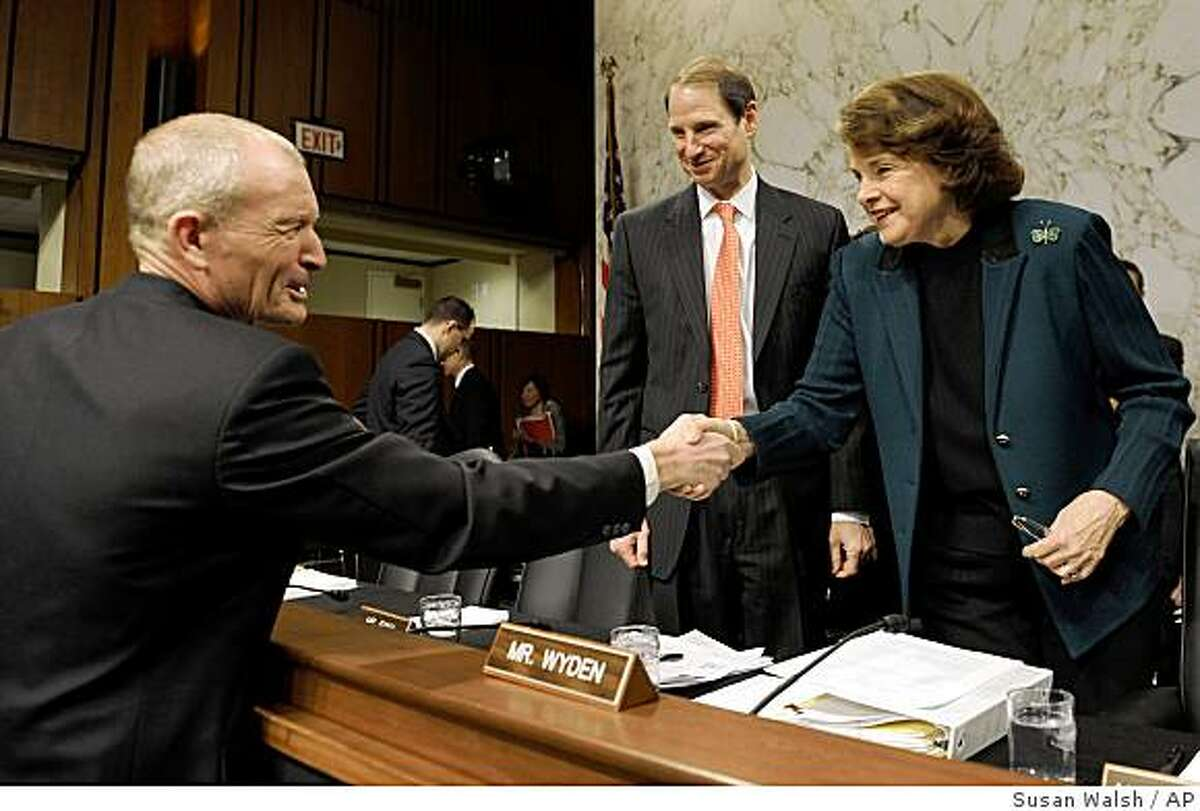 Senate Intelligence Committee Chair, Sen. Dianne Feinstein, D-Calif., accompanied by Sen. Ron Wyden, D-Ore, center, greets National Intelligence Director-designate Dennis Blair on Capitol Hill in Washington, Thursday, Jan. 22,2009, prior to the start of the committee's hearing on Blair's nomination. (AP Photo/Susan Walsh)