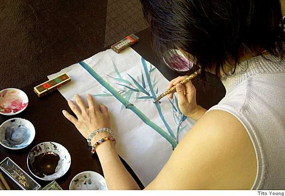 Chinese brush painter Pauline Tsui in her studio Photo: Tito Young
