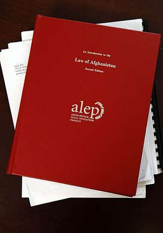 "Dr. Erik Jensen's text book ""An Introduction to the Law of Afghanistan"" sits on his desk in his office on Stanford's Campus, September 2, 2010, Stanford, Calif.  Dr. Erik Jensen leads a student team writing text books to teach the new Afghan law to Afghani students. Photo: Adm Golub, The Chronicle"