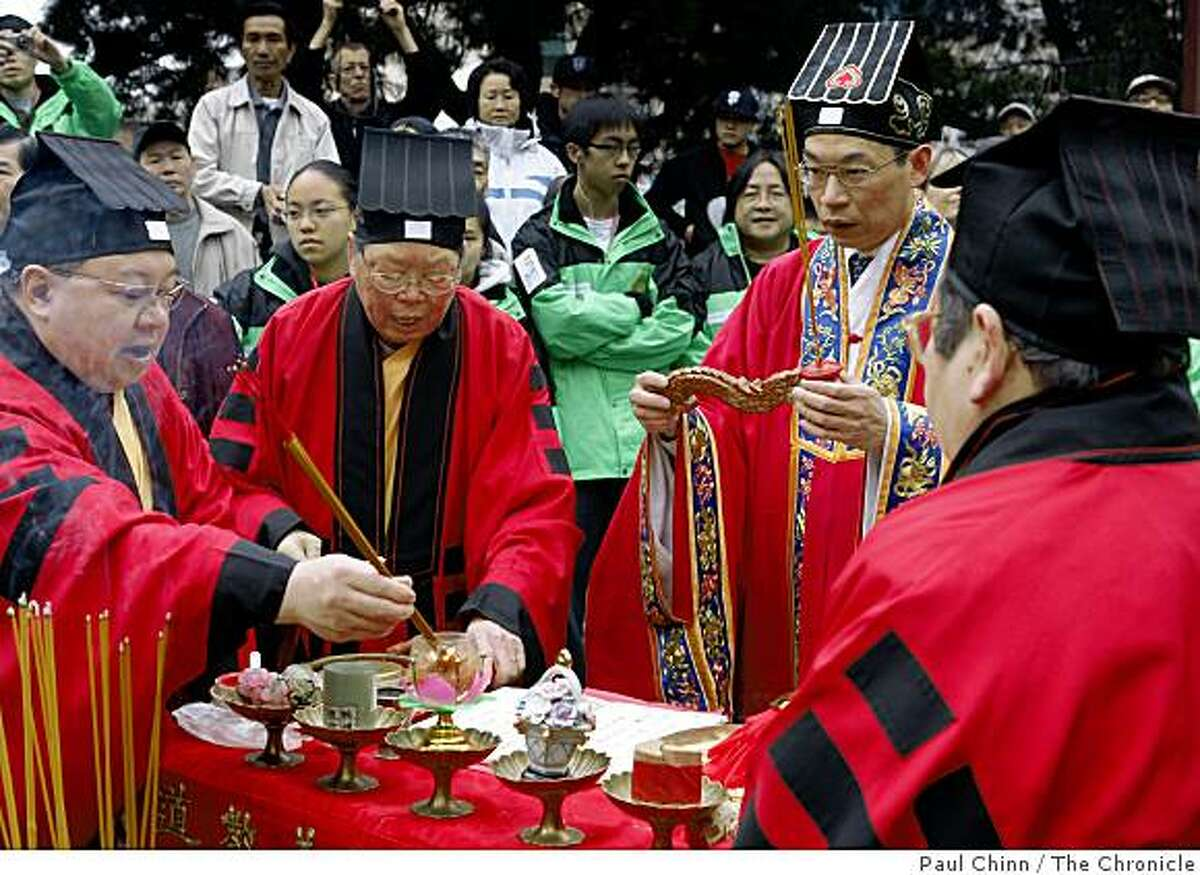 Taoist priests perform a ceremony to awaken Gum Lung, the Chinese New Year Parade dragon, in an eye-dotting ceremony at Portsmouth Square in San Francisco, Calif., on Saturday, Jan. 24, 2009.